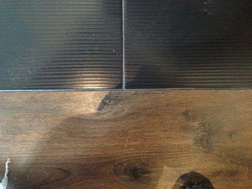 Стык между плиткой и ламинатом