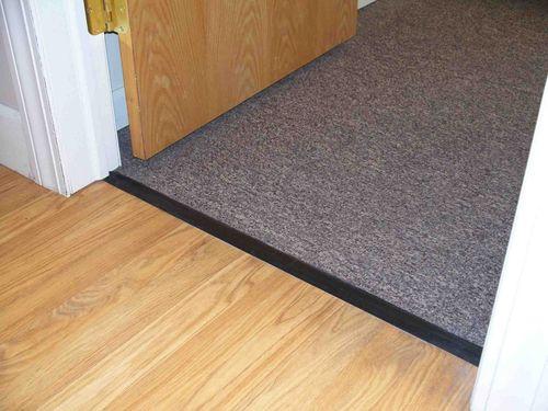 Пороги для ламината между комнатами со скрытым креплением